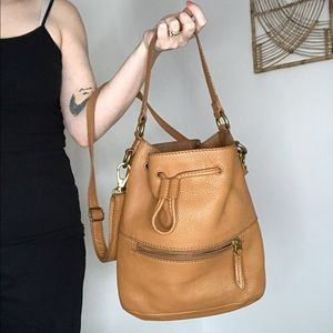 Fossil tan leather cross body bucket bag